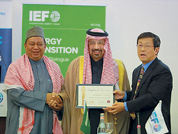 OPEC Secretary General (l) presents a certificate of appreciation to HE Al-Falih, Saudi Arabia's Minister of Energy, Industry & Mineral Resources (c), for participating in the symposium, with IEF Secretary General