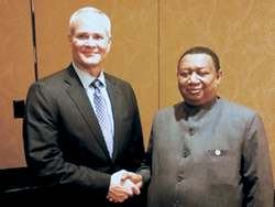 Mr. Darren Woods, Chairman & CEO, Exxon Mobil (l) with HE Barkindo