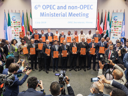 Group photo of OPEC and non-OPEC officials holding the Charter of Cooperation