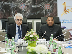 HE Mohammad Sanusi Barkindo, OPEC Secretary General (r), delivers his remarks at the meeting