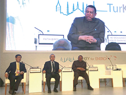 HE Mohammad Sanusi Barkindo, OPEC Secretary General (r) at a panel session; with HE Dr. Fatih Birol, IEA Executive Director (c); and HE Dr. Sun Xiansheng, IEF Secretary General