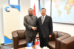 OPEC Secretary General, HE Mohammad Sanusi Barkindo (l), and the Administrator of the National Energy Administration of the People's Republic of China, HE Zhang Jianhua
