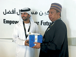 HE Barkindo, OPEC Secretary General (r) presents a gift to HE Al Mazrouei, UAE Minister of Energy